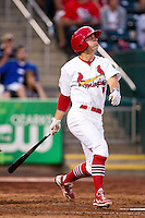 Greg Garcia (7) of the Springfield Cardinals follows through his swing during a game against the Arkansas Travelers at Hammons Field on June 13, 2012 in Springfield, Missouri. (David Welker/Four Seam Images)