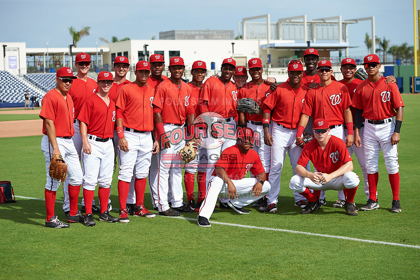 GCL Nationals manager Josh Johnson (kneeling left) poses for a photo with members of his team including (L-R) Luis Perdomo, Jackson Cramer, Phil Caulfield, Sean Adler, Luis Garcia, Jamori Blash, Yasel Antuna, Santo Falcon, Juan Pascal, Alex Dunlap, Edwin Ventura, Juan Evangelista, Eric Senior, Ricardo Mendez, Adalberto Carrillo, Jose Sanchez, and Justin Connell (kneeling right) before the first game of a doubleheader against the GCL Mets on July 22, 2017 at The Ballpark of the Palm Beaches in Palm Beach, Florida.  GCL Mets defeated the GCL Nationals 1-0 in a seven inning game that originally started on July 17th.  (Mike Janes/Four Seam Images)