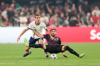 LAS VEGAS, NV - AUGUST 1: James Sands #16 of the United States battles for the ball with Hector Herrera #16 of Mexico during a game between Mexico and USMNT at Allegiant Stadium on August 1, 2021 in Las Vegas, Nevada.