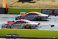 Sept. 24, 2011; Ennis, TX, USA: NHRA pro stock driver Greg Anderson (near lane) races alongside teammate Jason Line during qualifying for the Fall Nationals at the Texas Motorplex. Mandatory Credit: Mark J. Rebilas-