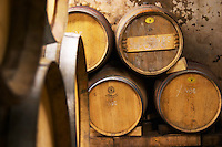 Wooden barrels in the wine cellar.  Alain Voge, Cornas, Ardeche, Ardèche, France, Europe