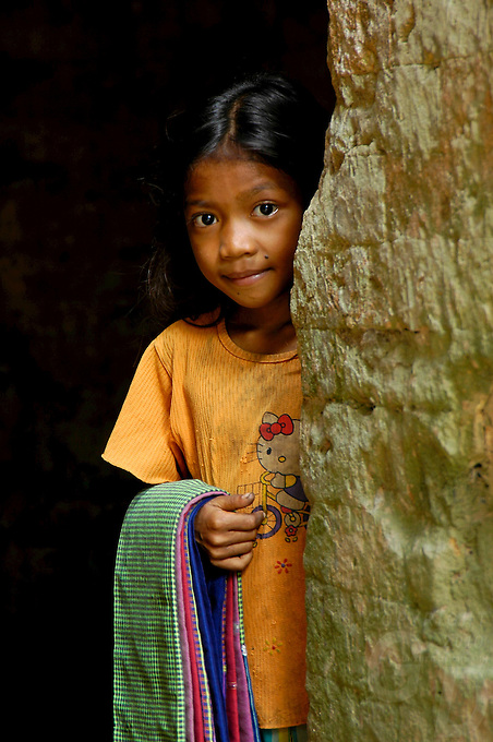 A shy young Girl in a temple, selling scarfs to the tourist,Angkor Wat area. Cambodia