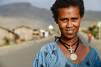 ETHIOPIA, Amhara, village near Gondar, amharic orthodox christian woman with tattooed cross on the forehead and cross necklace / AETHIOPIEN, Amhara, Gonder, orthodoxe Christin mit auf der Stirn taetowiertem Kreuz und Halskette in einem Dorf