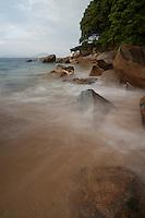 Afternoon, and the rising tide sweeps over the rocks of the Seto Inland Sea coast of Shikoku like a mist.