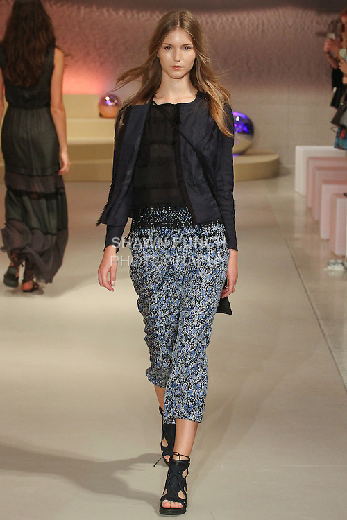 """Model walks runway in an outfit from the Elie Tahari Spring 2016 """"Future-Nature"""" collection, during New York Fashion Week Spring 2016."""