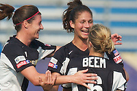 Jaclyn Raveia (center) of the Power celebrates scoring a goal with teammates Cheryl Salisbury and Heather Beam. The San Jose CyberRays were defeated by the NY Power played 2-1 on 7/05/03 at Mitchel Athletic Complex, Uniondale, NY..