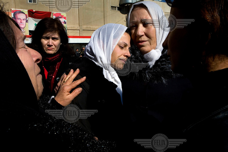 The mother and sister of Adjutant Marin Saleh Ahmad of the Syrian army comfort each other at his funeral in Damascus. He was shot in the chest by a sniper in the eastern suburbs of the city.Protests against the ruling Baathist regime of Bashar al-Assad erupted in March 2011. Although they were initially peaceful,  they were violently repressed by the Syrian army and police. In response to being ordered to shoot unarmed civilians, large numbers of men deserted the army and formed the Free Syrian Army. The protest movement has now turned into an armed uprising with clashes between the regular army and the Free Syrian Army taking place in early 2012..