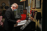 BNPS.co.uk (01202 558833)<br /> Pic: ZacharyCulpin/BNPS<br /> <br /> Good to go train guard Trevor Parsons in the signal room<br /> <br /> Full steam ahead for Swanage Railway reopening after lockdown<br /> <br /> Volunteers are gearing up for the reopening of one of Britain's most popular heritage railways.<br /> <br /> Swanage Railway in Dorset will resume running steam trains on Monday after the government gave the green light to easing coronavirus restrictions.<br /> <br /> The Purbeck railway has spent the fallow period by doing essential maintenance work on the locomotives, tracks and signals.<br /> <br /> They are attempting to raise £65,000 to complete a new carriage shed to store ten carriages which was interrupted by the pandemic.