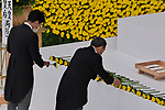 Japan's Japan's Chief Cabinet Secretary Yoshihide Suga(R) and Environment Minister Shinjiro Koizumi offer flowers the memorial service for the war dead of World War II marking the 75th anniversary in Tokyo, Japan on August 15, 2020. (Photo by AFLO)