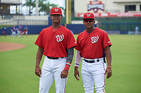 GCL Nationals Frailin Turbi (left) and Edangel Tovar (right) before a Gulf Coast League game against the GCL Mets on August 12, 2019 at FITTEAM Ballpark of the Palm Beaches in Palm Beach, Florida.  GCL Nationals defeated the GCL Mets 7-3.  (Mike Janes/Four Seam Images)