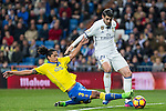 Mauricio Lemos l - competes for the ball with Isco Alarcon of Real Madrid  during the match of Spanish La Liga between Real Madrid and UD Las Palmas at  Santiago Bernabeu Stadium in Madrid, Spain. March 01, 2017. (ALTERPHOTOS / Rodrigo Jimenez)