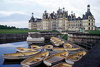 Chambord, France, Loire-et-Cher, Centre, Loire Castle Region, Europe, Loire Valley, Rowboats tied to dock at the 16th century Chateau de Chambord in the Loire Castle Region.