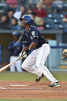 Asheville Tourists first baseman Correlle Prime #32 swings at a pitch during a game against the Rome Braves at McCormick Field on May 1, 2014 in Asheville, North Carolina. The Tourists defeated the Braves 8-7. (Tony Farlow/Four Seam Images)