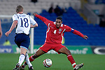 International Friendly match between Wales and Scotland at the new Cardiff City Stadium : Wales Captain Ashley Williams tries to block Scotlands Barry Robson's shot.