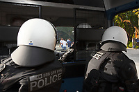 Switzerland. Canton Ticino. Lugano. Two police officers from TPO (Transport Police). Both The policemen wear the special riot police black uniforms and helmets. They seat inside the TPO van following the FC Luzern football club's supporters walking towards the Cornaredo stadium. The ultras fans can become violent at any time.TPO (Transport Police) is the Swiss Federal Railways Police. Swiss Federal Railways (German: Schweizerische Bundesbahnen (SBB), French: Chemins de fer fédéraux suisses (CFF), Italian: Ferrovie federali svizzere (FFS)) is the national railway company of Switzerland. It is usually referred to by the initials of its German, French and Italian names, as SBB CFF FFS. 2.06.2017 © 2017 Didier Ruef