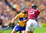 Shane O Donnell of Clare in action against Padraig Mannion of Galway during their All-Ireland semi-final replay at Semple Stadium,Thurles. Photograph by John Kelly.
