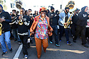 "Creola ""Jackie"" Moon, who co-founded the Lady Jetsetters Secondline in 1989, parades with the Stooges Brass Band, uptown, 2016"