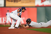 Cedar Rapids Kernels second baseman Rafael P Valera (17) tags out Cody Regis (18) sliding into second during a game against the Kane County Cougars on August 18, 2015 at Perfect Game Field in Cedar Rapids, Iowa.  Kane County defeated Cedar Rapids 1-0.  (Mike Janes/Four Seam Images)
