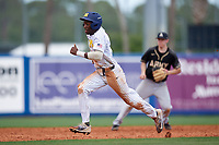 Michigan Wolverines right fielder Christan Bullock (5) running the bases during a game against Army West Point on February 18, 2018 at Tradition Field in St. Lucie, Florida.  Michigan defeated Army 7-3.  (Mike Janes/Four Seam Images)