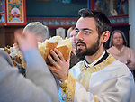 Slava of St. John the Baptist, Jovandan, St. Sava Jackson with the Deacon Tom Paul family celebrating their family's saint.<br /> <br /> Blessing and turning of the slavski kolach