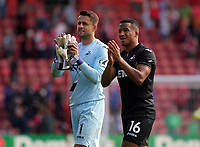 (L-R) Lukasz Fabianski of Swansea City and Matrin Olsson thank away supporters at the end of the game during the Premier League match between Southampton and Swansea City at the St Mary's Stadium, Southampton, England, UK. Saturday 12 August 2017