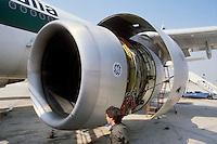 - turbofan engine maintenance  on a Boeing 747 Alitalia aircraft in the airport of Milan Malpensa....- manutenzione motori turbofan di un aereo Boeing 747 Alitalia all'aeroporto di Milano Malpensa