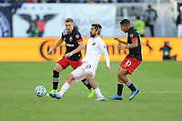 WASHINGTON, DC - MARCH 07: Rodolfo Pizarro #10 of Inter Miami CF battles the ball with Russell Canouse #4 and Edison Flores #10 of D.C. United during a game between Inter Miami CF and D.C. United at Audi Field on March 07, 2020 in Washington, DC.