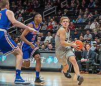 WASHINGTON, DC - DECEMBER 28: Mac McClung #2 of Georgetown moves past Stacy Beckton JR. #2 of American on his way to shoot. during a game between American University and Georgetown University at Capital One Arena on December 28, 2019 in Washington, DC.