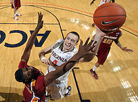 Dec. 30, 2010; Charlottesville, VA, USA; Virginia Cavaliers forward Will Regan (4) shoots over Iowa State Cyclones forward Calvin Godfrey (15) during the game at the John Paul Jones Arena. Iowa State Cyclones won 60-47. Mandatory Credit: Andrew Shurtleff-