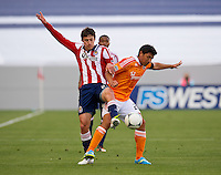 CARSON, CA - March 11, 2012: Chivas USA midfielder Ben Zemanski (21) and Houston Dynamo forward Brian Ching (25) during the Chivas USA vs Houston Dynamo match at the Home Depot Center in Carson, California. Final score Houston Dynamo 1, Chivas USA 0.