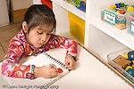 Preschool Headstart 3-5 year olds art activity girl drawing with marker horizontal
