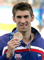 U.S. Michael Phelps shows his gold medal after setting the new world record clocking 1:52.03 n the Men's 200m Butterfly, at the Swimming World Championships in Rome, 29 July 2009..UPDATE IMAGES PRESS/Riccardo De Luca
