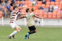 Houston, TX - Friday December 11, 2016: Drew Skundrich (12) of the Stanford Cardinal and Jacori Hayes (8) of the Wake Forest Demon Deacons battle for control of a loose ball at the NCAA Men's Soccer Finals at BBVA Compass Stadium in Houston Texas.