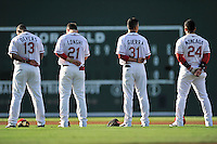 Members of the Greenville Drive infield stand for the National Anthem before a game against the Augusta GreenJackets on Thursday, July 16, 2015, at Fluor Field at the West End in Greenville, South Carolina. They are Rafael Devers, Nick Longhi, Javier Guerra and Yoan Moncada. Greenville won, 11-5. (Tom Priddy/Four Seam Images)