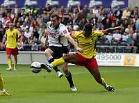 ATTENTION SPORTS PICTURE DESK<br /> Pictured: Craig Beattie of Swansea (L) tackled by Adrian Mariappa of Watford  (R)<br /> Re: Coca Cola Championship Swansea City Football Club v Watford at the Liberty Stadium, Swansea, south Wales. Saturday 29 August 2009<br /> Picture by D Legakis Photography / Athena Picture Agency, 24 Belgrave Court, Swansea, SA1 4PY, 07815441513