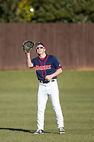 Shippensburg Raiders left fielder Dustin LaBonte (15) warms up between innings of the game against the Belmont Abbey Crusaders at Abbey Yard on February 8, 2015 in Belmont, North Carolina.  The Raiders defeated the Crusaders 14-0.  (Brian Westerholt/Four Seam Images)