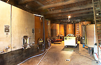 Domaine Borie la Vitarèle Causses et Veyran St Chinian. Languedoc. Concrete fermentation and storage vats. Wine press. France. Europe.