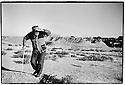 Uzbekistan - Farmer on Afrosiab hill watching his sheeps.