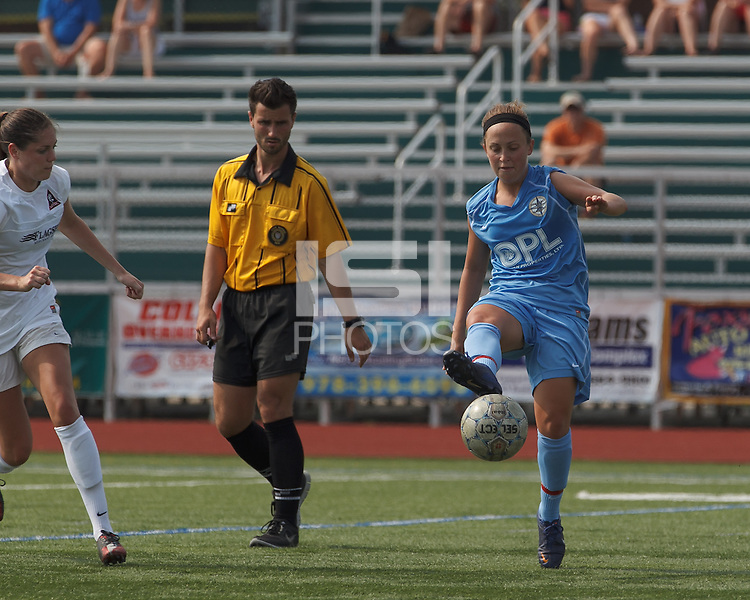 Seacoast United Mariners midfielder Krista Hagen (14) traps the ball. In a Women's Premier Soccer League (WPSL) match, Boston Aztec (white) defeated Seacoast United Mariners (blue), 2-1, at North Reading High School Stadium on Arthur J. Kenney Athletic Field on on June 23, 2013. Due to injuries through the season, Seacoast United Mariners could only field 10 players.