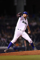 Tulsa Drillers pitcher Kraig Sitton (15) delivers a pitch during a game against the Midland RockHounds on May 31, 2014 at ONEOK Field in Tulsa, Oklahoma.  Tulsa defeated Midland 5-3.  (Mike Janes/Four Seam Images)