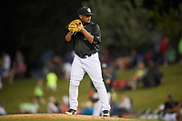 Kane County Cougars relief pitcher Erbert Gonzalez (7) gets ready to deliver a pitch during a game against the South Bend Cubs on July 21, 2018 at Northwestern Medicine Field in Geneva, Illinois.  South Bend defeated Kane County 4-2.  (Mike Janes/Four Seam Images)