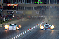 Jul, 20, 2012; Morrison, CO, USA: NHRA funny car driver Jack Beckman (left) races alongside Cruz Pedregon during qualifying for the Mile High Nationals at Bandimere Speedway. Mandatory Credit: Mark J. Rebilas-US PRESSWIRE