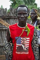 Friends and relatives (this man wearing a T-shirt featuring US President Barack Obama) celebrate Joseph Gatyoung Khan's homecoming. Joseph is a Lost Boy. He was among the thousands who fled Sudan during the civil war, and after living in the United States, he is returning for the first time in 22 years. Many Sudanese are returning home, mainly to participate in the upcoming referendum in January 2011 when South Sudan will vote on its independence.