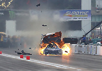 Sep 28, 2019; Madison, IL, USA; NHRA funny car driver Tim Wilkerson explodes the engine of his car on fire and blows the body off during qualifying for the Midwest Nationals at World Wide Technology Raceway. Wilkerson would be uninjured in the incident. Mandatory Credit: Mark J. Rebilas-USA TODAY Sports