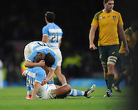 Nicolas Sanchez of Argentina comforts team mate Santiago Cordero of Argentina at the end of the Semi Final of the Rugby World Cup 2015 between Argentina and Australia - 25/10/2015 - Twickenham Stadium, London<br /> Mandatory Credit: Rob Munro/Stewart Communications