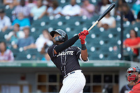 Eloy Jimenez (16) of the Charlotte Knights follows through on his swing against the Pawtucket Red Sox at BB&T BallPark on July 19, 2018 in Charlotte, North Carolina. The Knights defeated the Red Sox 4-3.  (Brian Westerholt/Four Seam Images)