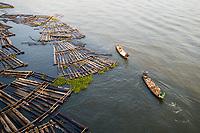 Nigeria Wood logs and boats in Makoko slum, in Lagos.
