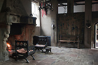 The great stone fireplace, with its carved overmantel is still a warm place to sit in the drafty banqueting hall
