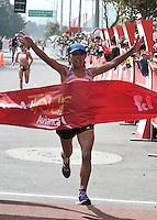 BOGOTA – COLOMBIA – 16-03-2013: Karina Villazana, de Peru, en damas, se impuso en la segunda versión del Avianca RunTour 2014, cerca de 10000 atletas participaron, por las calles de Bogota. Avianca impulsado a promover el atletismo como deporte universal, al tiempo contribuye a la salud de los niños de escasos recursos económicos que requieren atención medica y quirúrgica especializada, es asi como Avianca entrega a la Fundacion Cardio Infantil los dineros recaudados para la dotación de la Unidad de Cuidados Intensivos de Neonatos. / Karina Villazana of Peru, in ladies, won the second version of Avianca RunTour 2014, nearly 10,000 athletes participated, through the streets of Bogota. Avianca driven to promote athletics as universal sport, while contributing to the health of children of low income who require specialized medical and surgical care, is also Avianca delivery to the Fundacion Cardio Infantil, the monies raised for the endowment of the unit Neonatal Intensive Care. Photo: VizzorImage / Luis Ramirez / Staff.