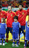 Spain's players Andres Iniesta and Cesc Fabregas listening to the national anthem before international match of the qualifiers for the FIFA World Cup Brazil 2014.March 22,2013.(ALTERPHOTOS/Victor Blanco)